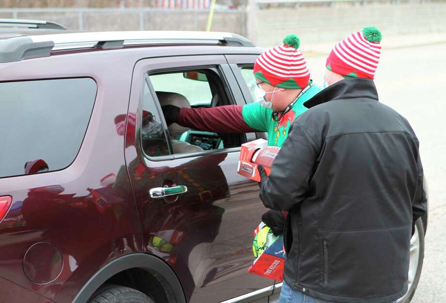 Many Big Rapids area residents showed up to the Season of Giving gift drive this weekend to make donations to Eagle Village. Donations included toys, blankets, winter hats, money and more. (Pioneer photo/Taylor Fussman)