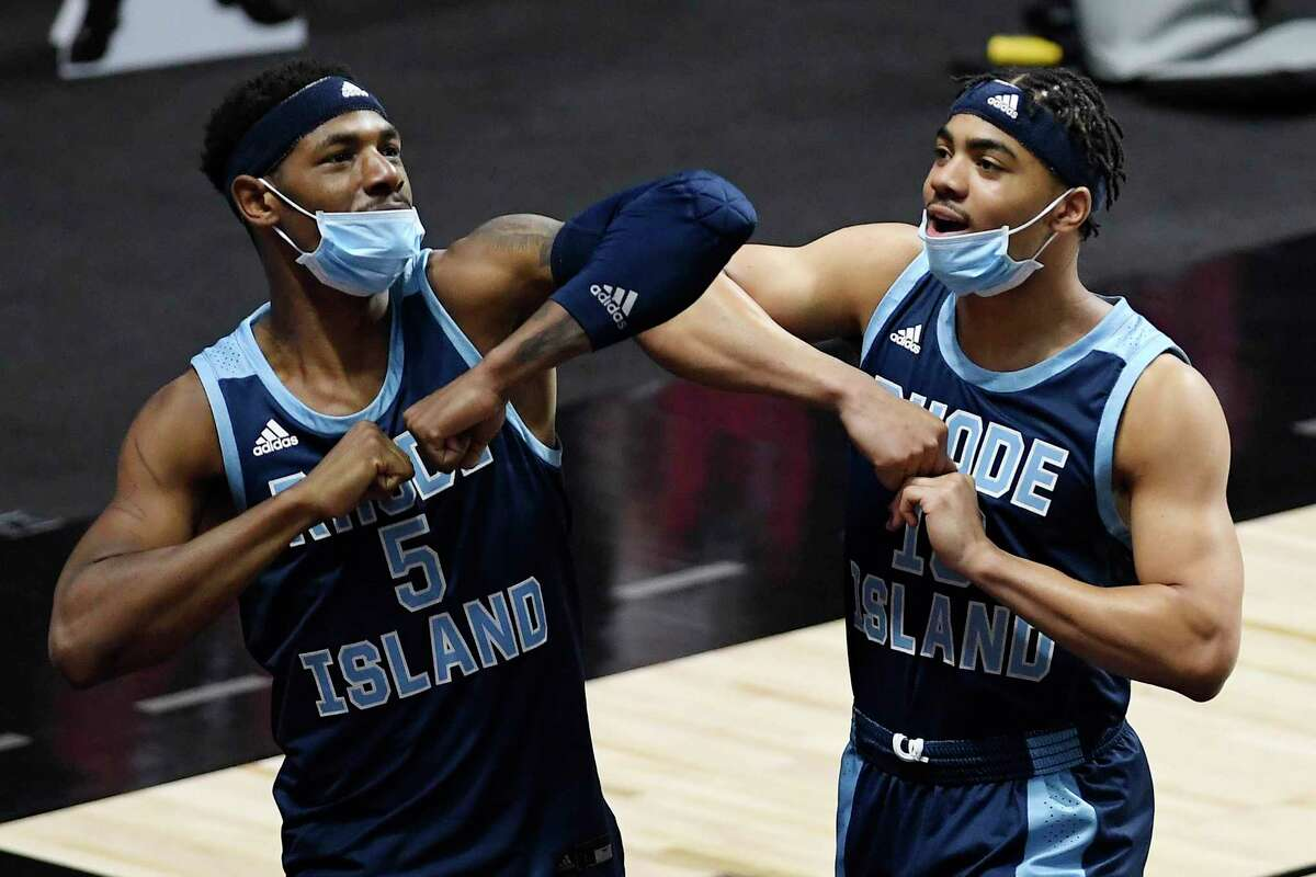 Rhode Island's Antwan Walker, left, and Ishmael Leggett dance in celebration during the second half of the team's NCAA college basketball game against South Florida, Saturday, Nov. 28, 2020, in Uncasville, Conn. (AP Photo/Jessica Hill)