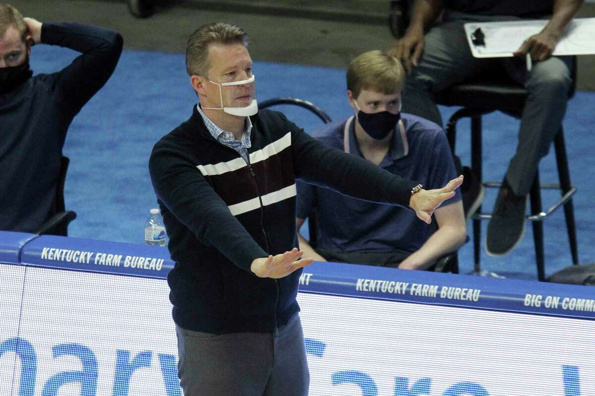 Richmond head coach Chris Mooney directs his team against Kentucky during the second half of an NCAA college basketball game in Lexington, Ky., Sunday, Nov. 29, 2020. (AP Photo/James Crisp)