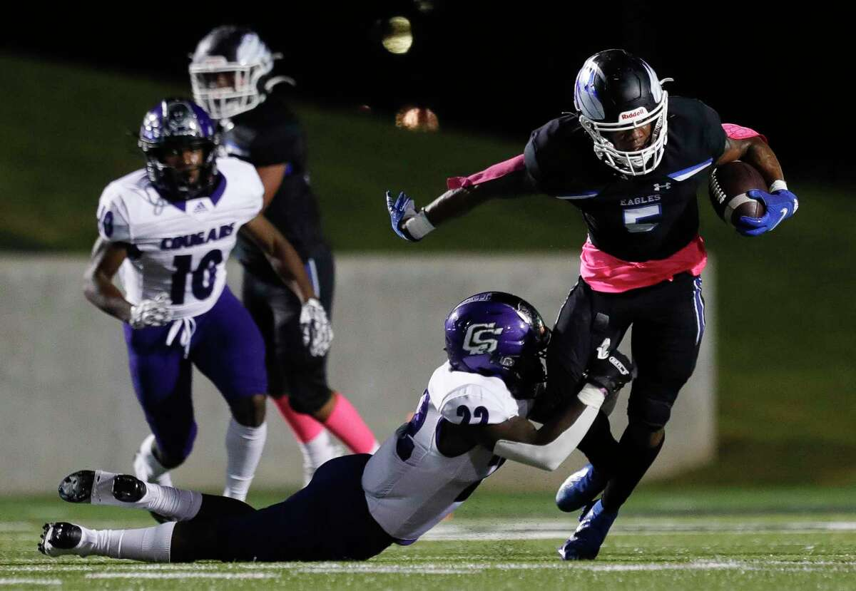 New Caney wide receiver D'Juan Grant (5) is tackled by College Station linebacker Harrison Robinson (22) during the first quarter of a District 8-5A high school football game at Randall Reed Stadium, Thursday, Oct. 22, 2020, in New Caney.