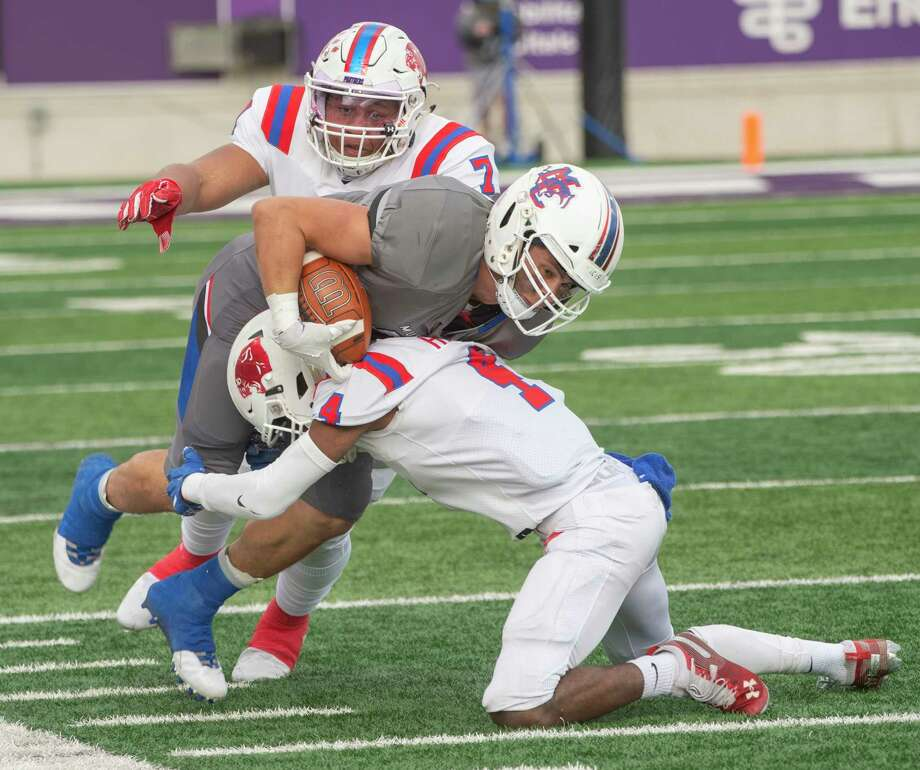 Midland Christian's Brad Evans is brought down by Dallas Parish Episcopal's Omari Hayes, 4, and Jaylon Hall 12/05/2020 at Anthony Field on Abilene Christian University campus. Tim Fischer/Reporter-Telegram Photo: Tim Fischer, Midland Reporter-Telegram