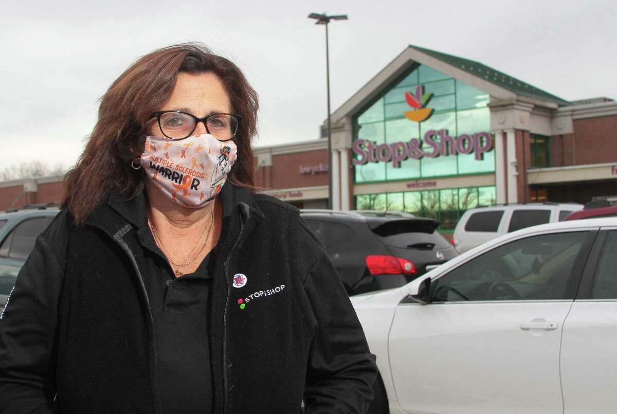 Employee Pat Valdez poses at the Stop & Shop along Whaley Avenue in New Haven, Conn., on Friday Dec. 4, 2020.