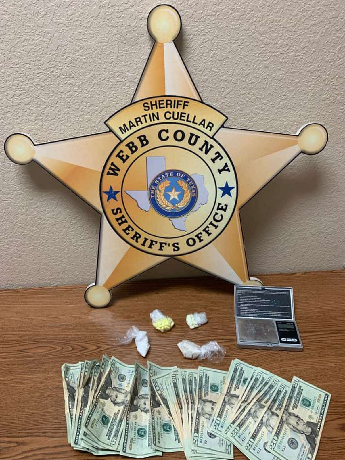 The Webb County Sheriff's Office along with the Texas Department of Public Safety seized the narcotics and cash shown in this photo. The raid occurred Friday in the 2500 block of Cortez Street.