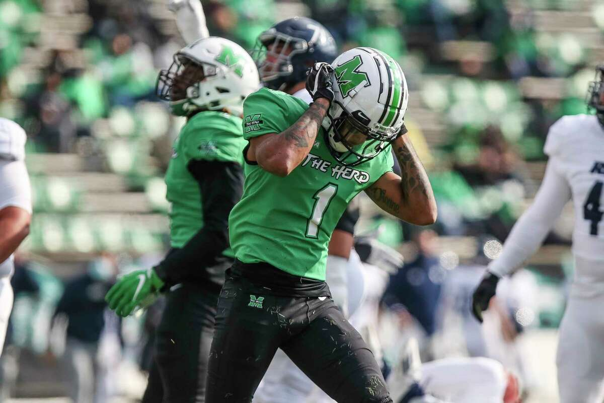 Marshall safety Derrek Pitts (1) drops his head after a score by Rice during an NCAA college football game on Saturday, Dec. 5, 2020, in Huntington, W.Va. (Sholten Singer/The Herald-Dispatch via AP)