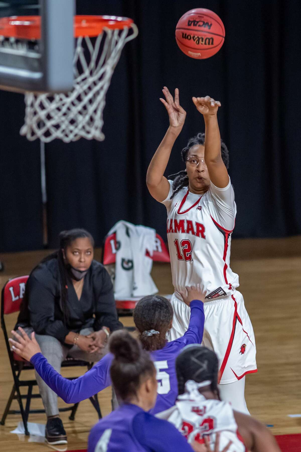 Micaela Wilson (12) puts up a shot in the second half. The Lamar Lady Cardinals downed the Tarleton State TexAnns in their home openier Saturday afternoon at the Montagne Center. Photo made on December 5, 2020. Fran Ruchalski/The Enterprise