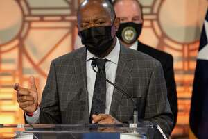 Houston Mayor Sylvester Turner encourages citizens continue wearing masks and stay away from large gatherings during a COVID-19 press conference Thursday, Dec. 3, 2020, at City Hall in Houston.