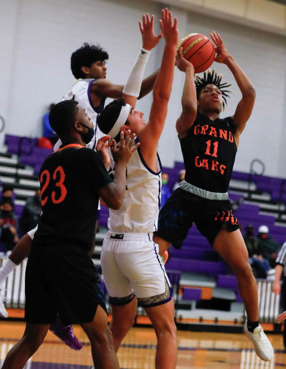 Grand Oaks guard Jordan Reece (11) is fouled as he shoots during the second quarter of a non-district high school basketball game at Montgomery High School, Saturday, Dec. 5, 2020, in Montgomery.