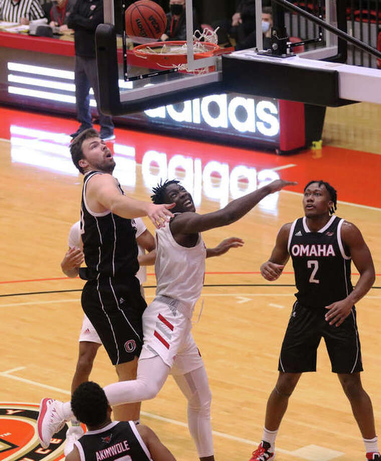 SIUE's Mike Adewunmi (middle) and Omaha's Matt Pile (left) watch Adewunmi's shot bounce on the rim Saturday at First Community Arena in Edwardsville. Photo: Greg Shashack / The Telegraph