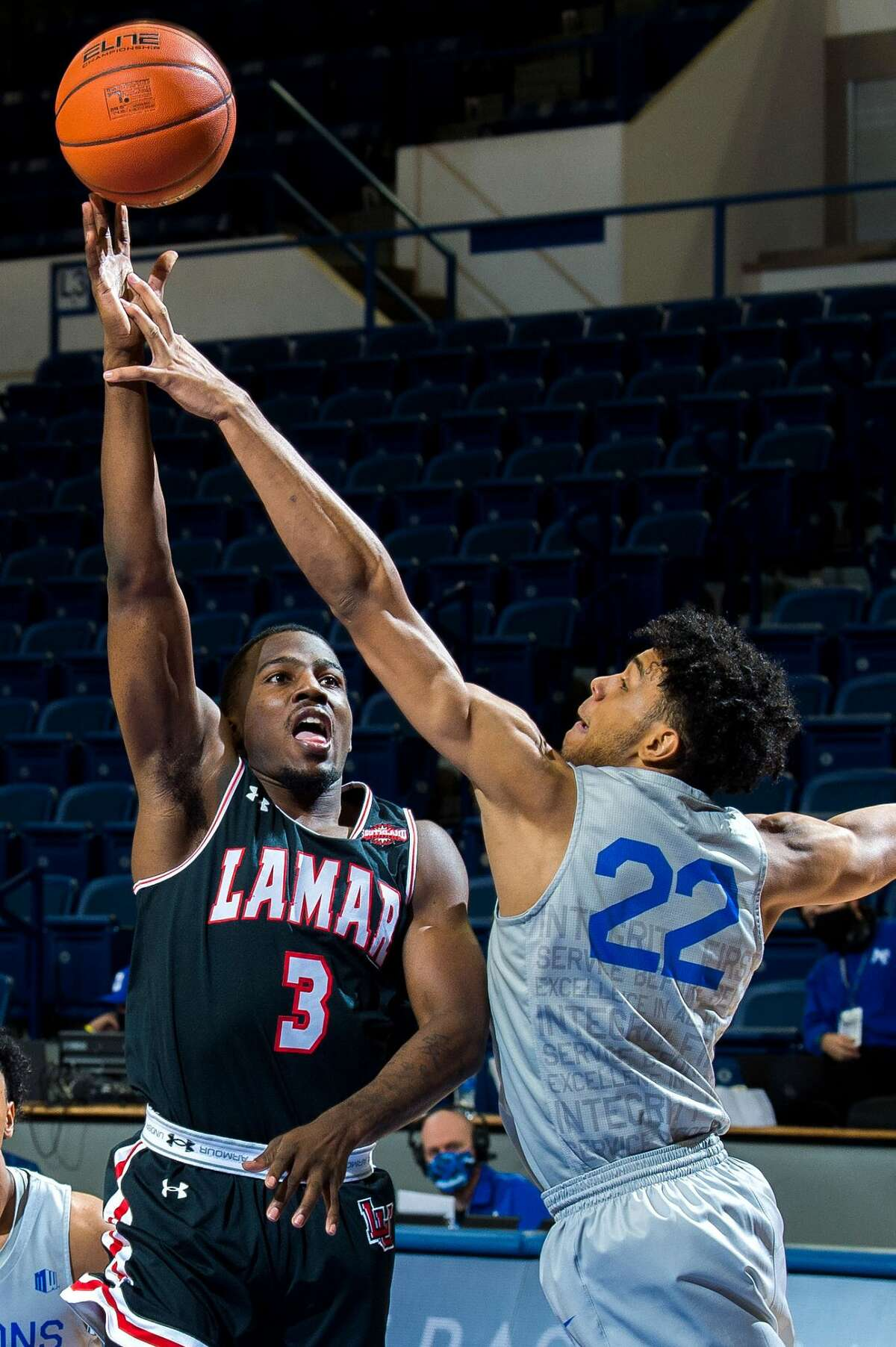 Lamar guard Ellis Jefferson attempts a shot over an Air Force defender during the Cardinals' loss Saturday afternoon in Colorado Springs, Colorado. (U.S. Air Force photo/Trevor Cokley)