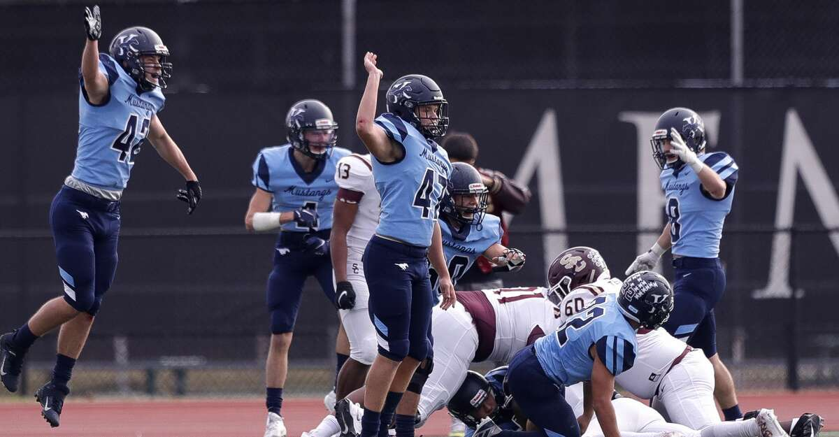 Kingwood players react after Grant Mize forces a turnover by Summer Creek quarterback Bryan Bush during the fourth quarter of a District 21-6A high school football game at Turner Stadium, Saturday, Dec. 5, 2020, in Humble.