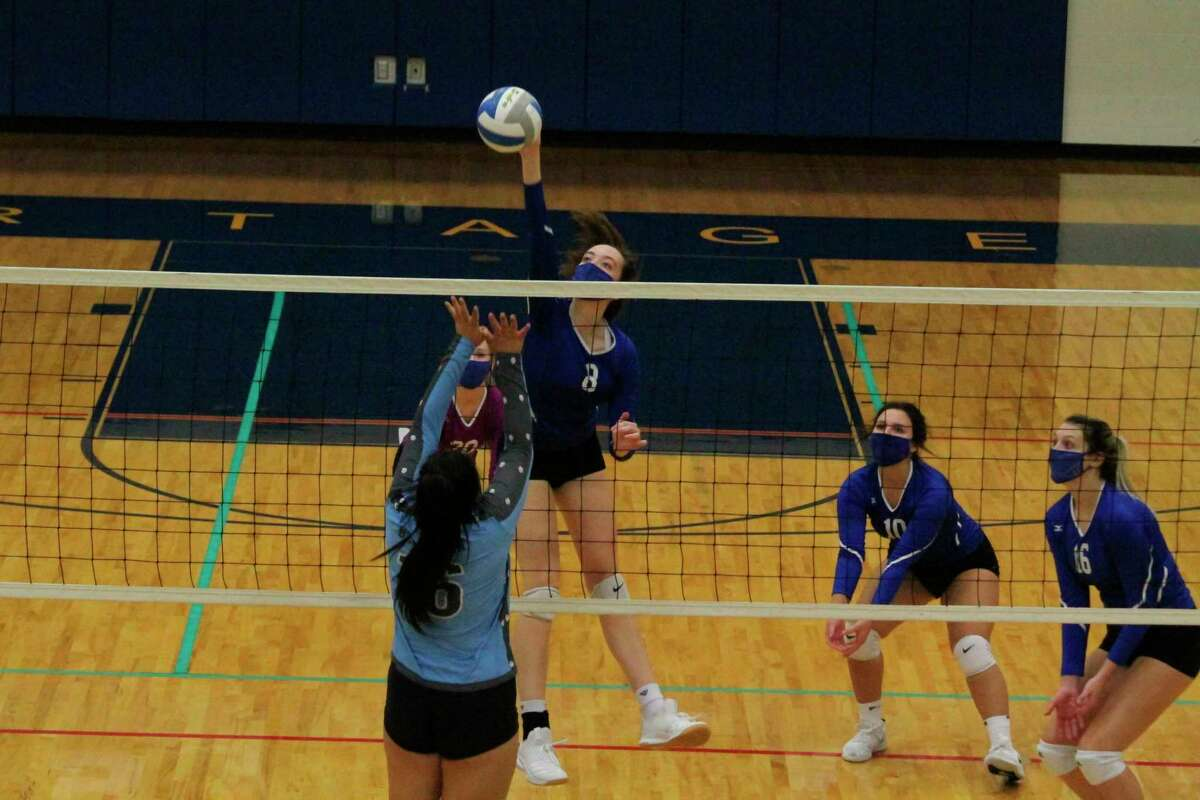 Kristin Bonecutter comes down with abig hit at the net during Onekama's victory over Brethren in the district championship game on Nov. 5. (File photo)