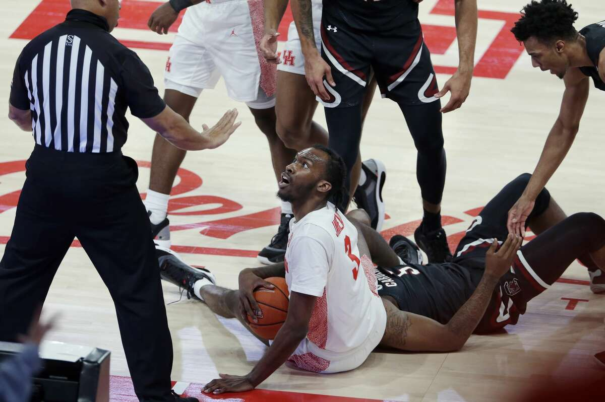 Houston guard DeJon Jarreau (3) looks up at a referee after being called for a foul while scrambling for the ball with South Carolina guard Jermaine Couisnard during the second half of an NCAA college basketball game Saturday, Dec. 5, 2020, in Houston. (AP Photo/Michael Wyke)