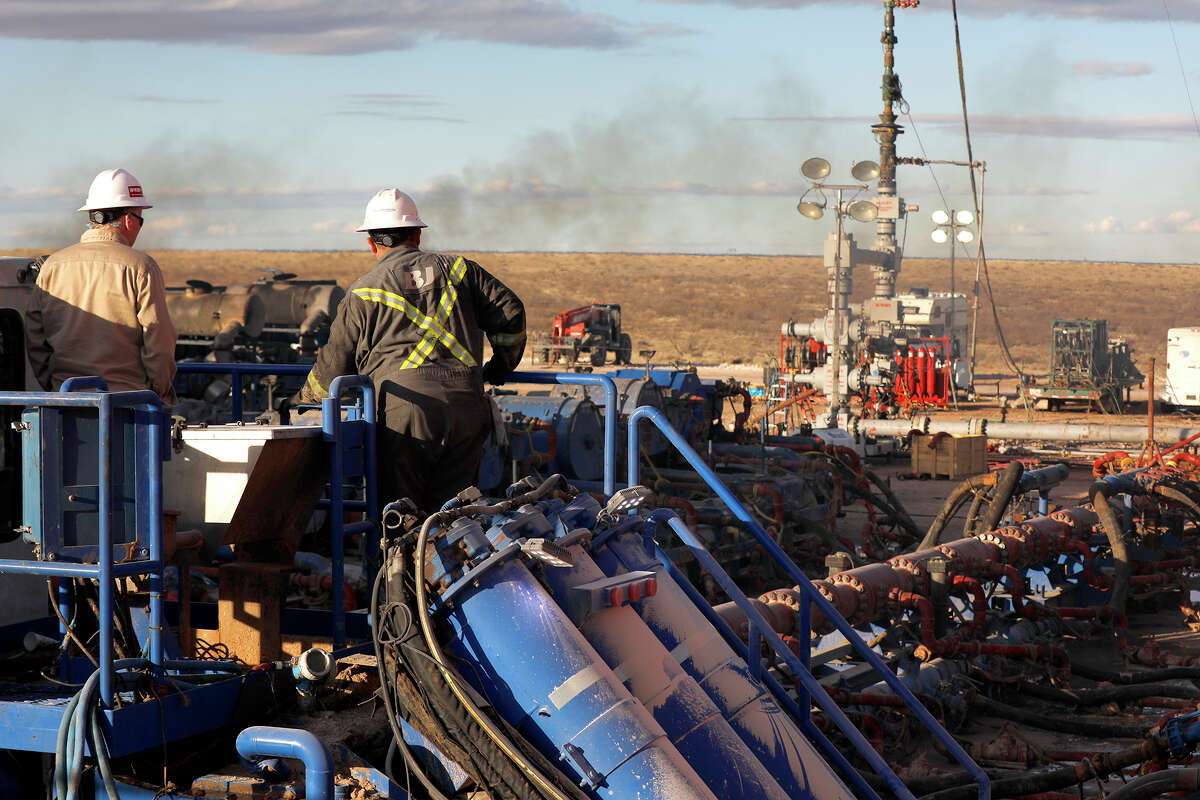 A BJ Services frack crew operates on a well site near Eunice, N.M., in January. A TIPRO report on hiring and workforce trends finds the addition of jobs in the energy industry, with the upstream segment adding jobs fin September and October.