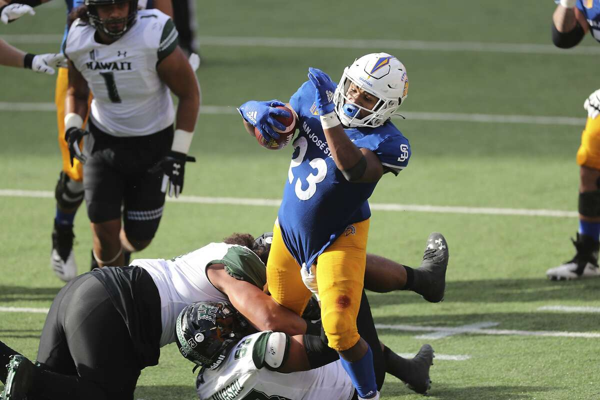 San Jose State running back Tyler Nevens (23) runs through the Hawaii defense during the second half in Honolulu. Nevens ran 16 times for 152 yards and two first-quarter touchdowns.