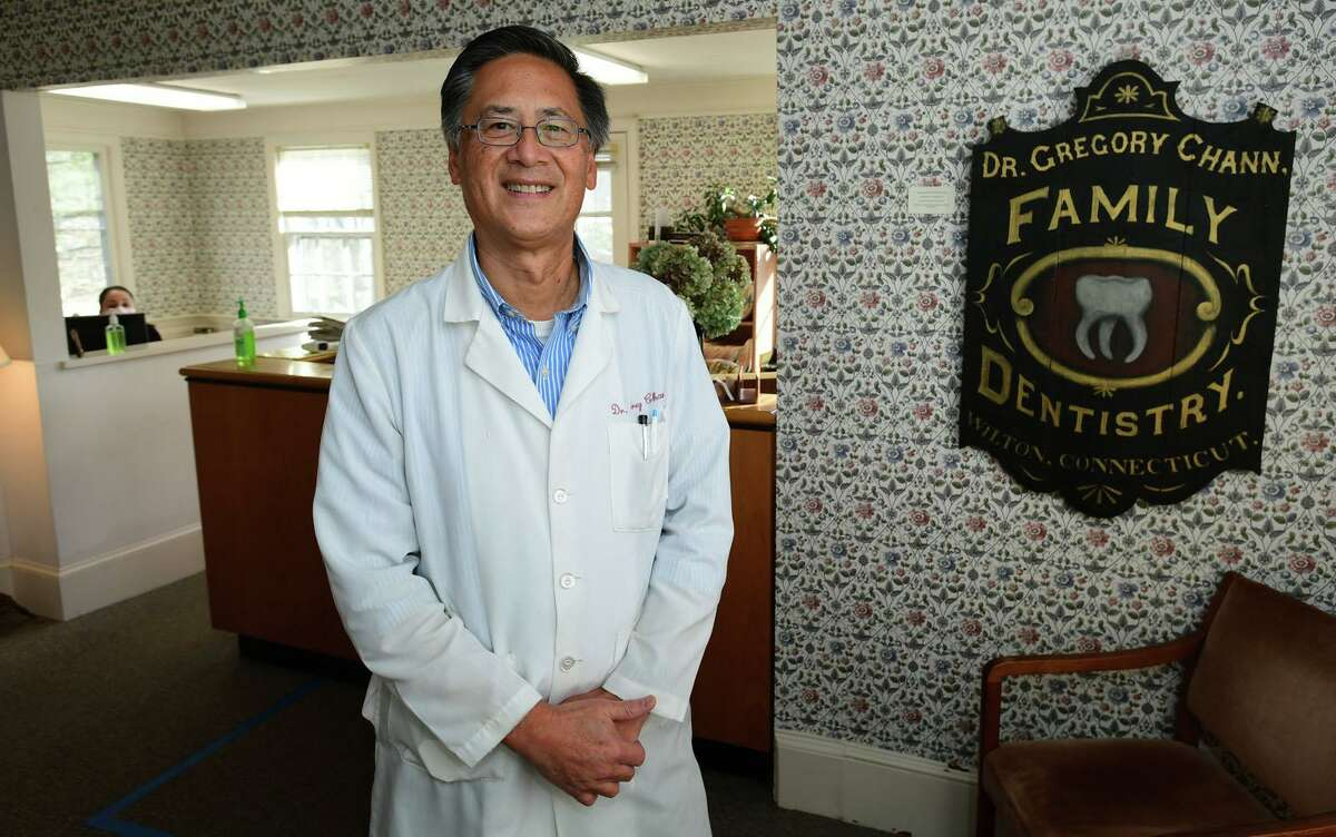 Dr. Greg Chann, DDS, at his Wilton office on Dec. 3. He agrees damage to teeth as a result of stress has increased since the beginning of the pandemic.