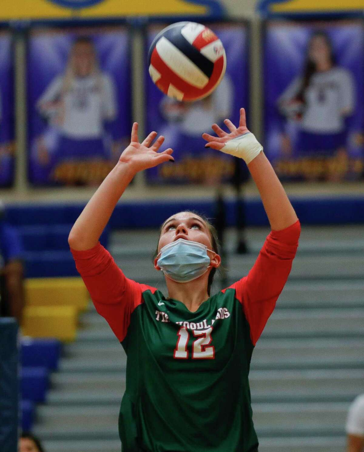 The Woodlands setter Clara Brower (13) sets the ball during the first set of a non-district high school volleyball match at Klein High School, Saturday, Oct. 10, 2020, in Spring.