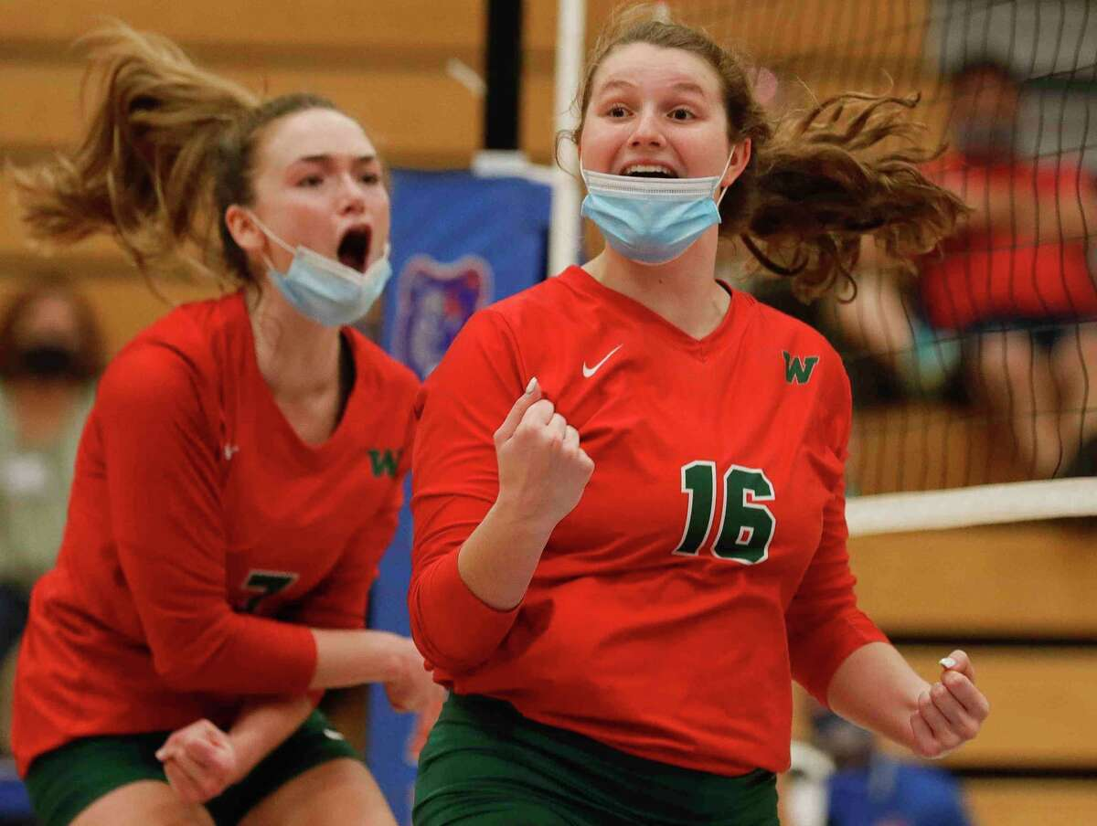 The Woodlands' Marjorie Johnson reacts after scoring a point during the fourth set of a District 13-6A high school volleyball match at Grand Oaks High School, Tuesday, Oct. 20, 2020, in Spring.