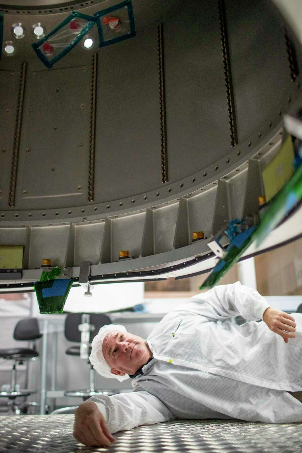 Brock Howe, Nanoracks airlock project manager observes inside the Nanoracks Bishop Airlock module on Wednesday, Aug. 14, 2019, in Webster.