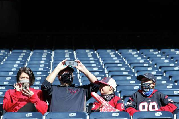 Houston Texans fans watch the players warm up before an NFL football game against the Indianapolis Colts at NRG Stadium on Sunday, Dec. 6, 2020, in Houston. Photo: Brett Coomer, Staff Photographer / © 2020 Houston Chronicle