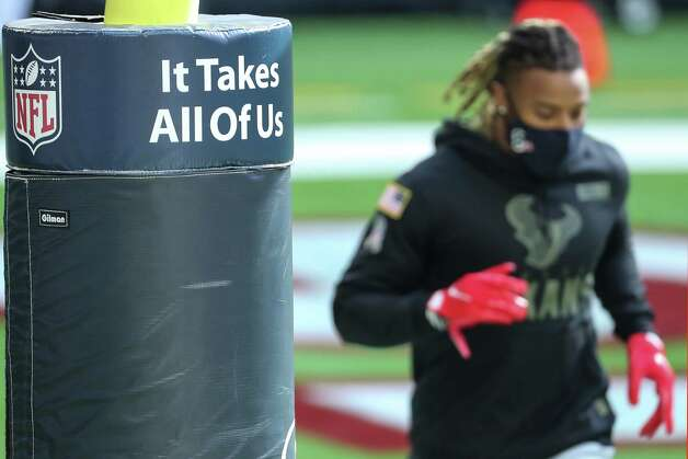 "Houston Texans strong safety Justin Reid jogs around the field past the goal post with the ""It Takes All Of Us"" message before an NFL football game against the Indianapolis Colts at NRG Stadium on Sunday, Dec. 6, 2020, in Houston. Photo: Brett Coomer, Staff Photographer / © 2020 Houston Chronicle"