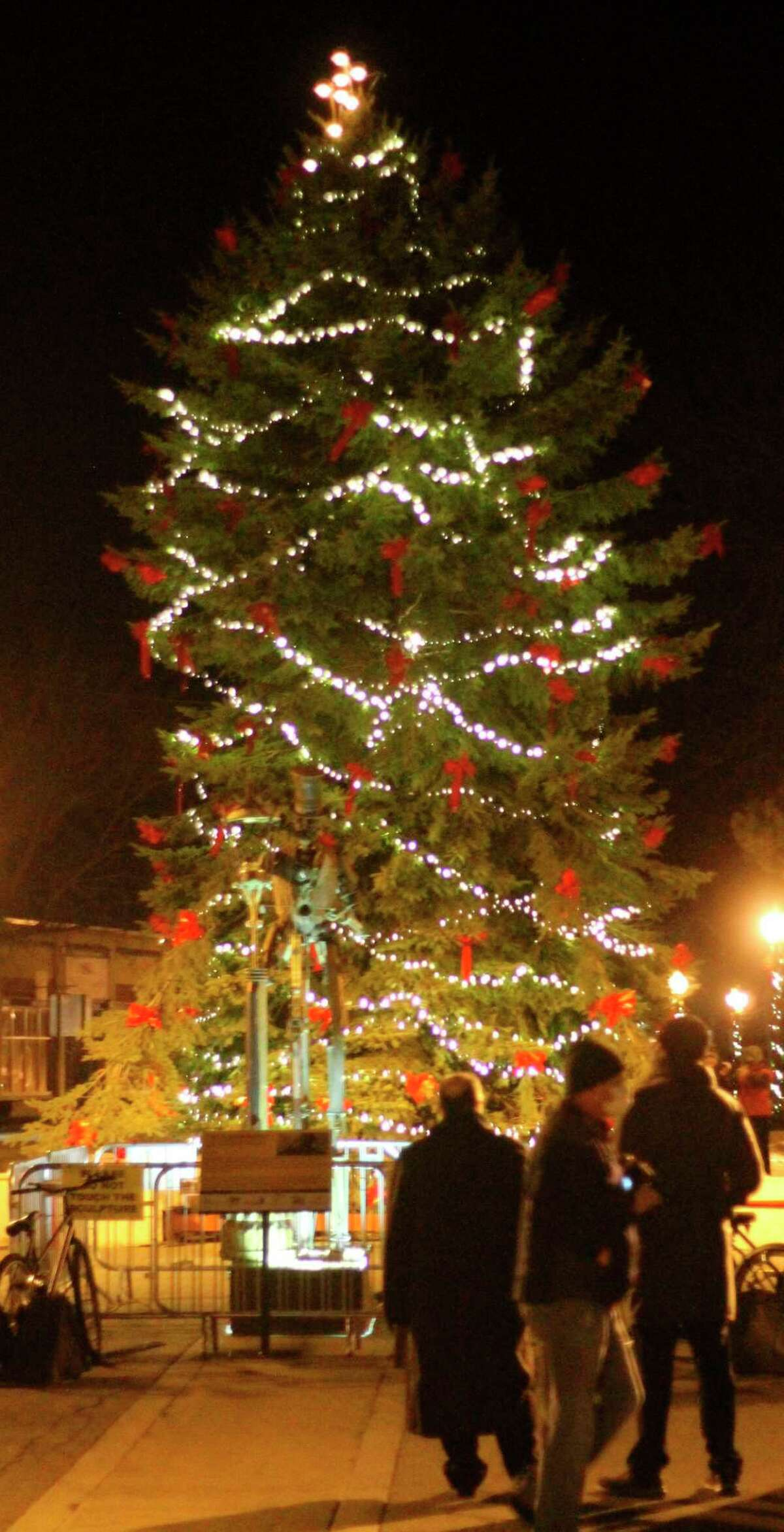 A 45-foot spruce tree was lit in downtown Manistee Saturday during a virtual tree lighting ceremony which was broadcast on Facebook Live. (Kyle Kotecki/News Advocate)