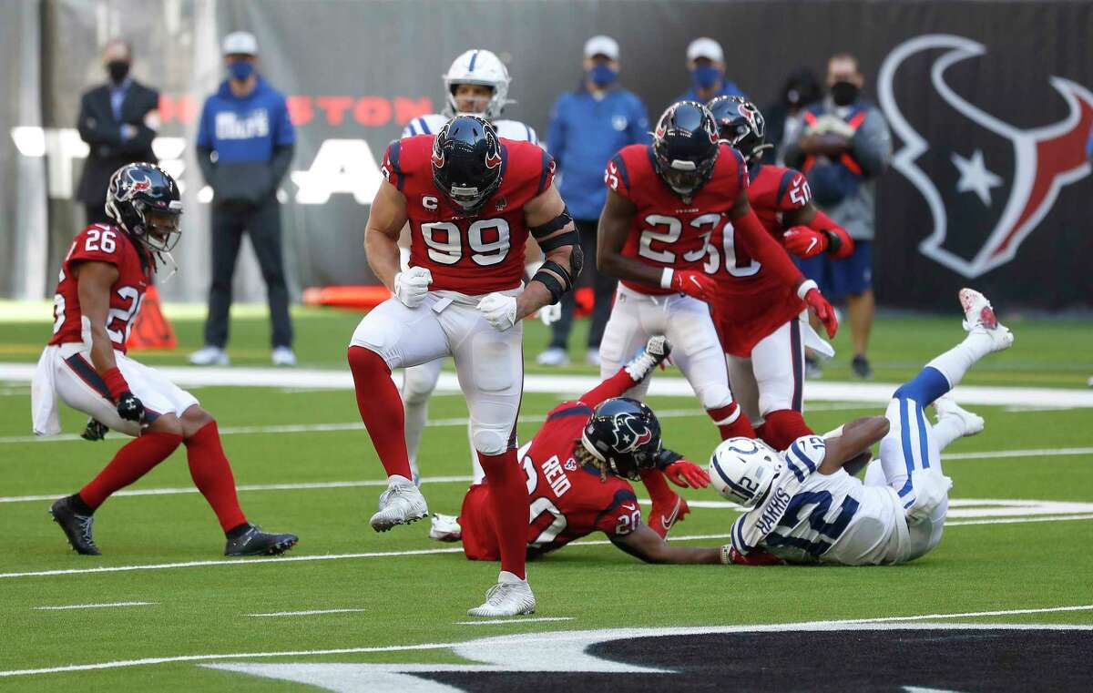 Houston Texans defensive end J.J. Watt (99) celebrates his part in stopping Indianapolis Colts wide receiver De'Michael Harris (12) bring up a fourth down in the second quarter of an NFL football game at NRG Stadium, Sunday, December 6, 2020, in Houston.