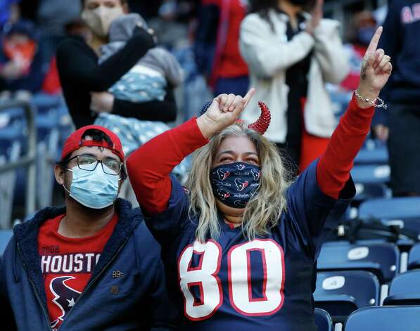 A Houston Texans fan celebrates a texans touchdown during the first half of an NFL football game at NRG Stadium, Sunday, December 6, 2020, in Houston. Photo: Karen Warren, Staff Photographer / © 2020 Houston Chronicle