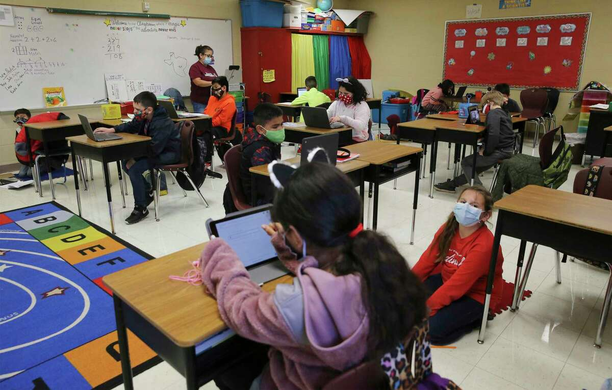Third grade students at Pearce Elementary at Southside ISD attend a combination of online and in-person class learning on Thursday.