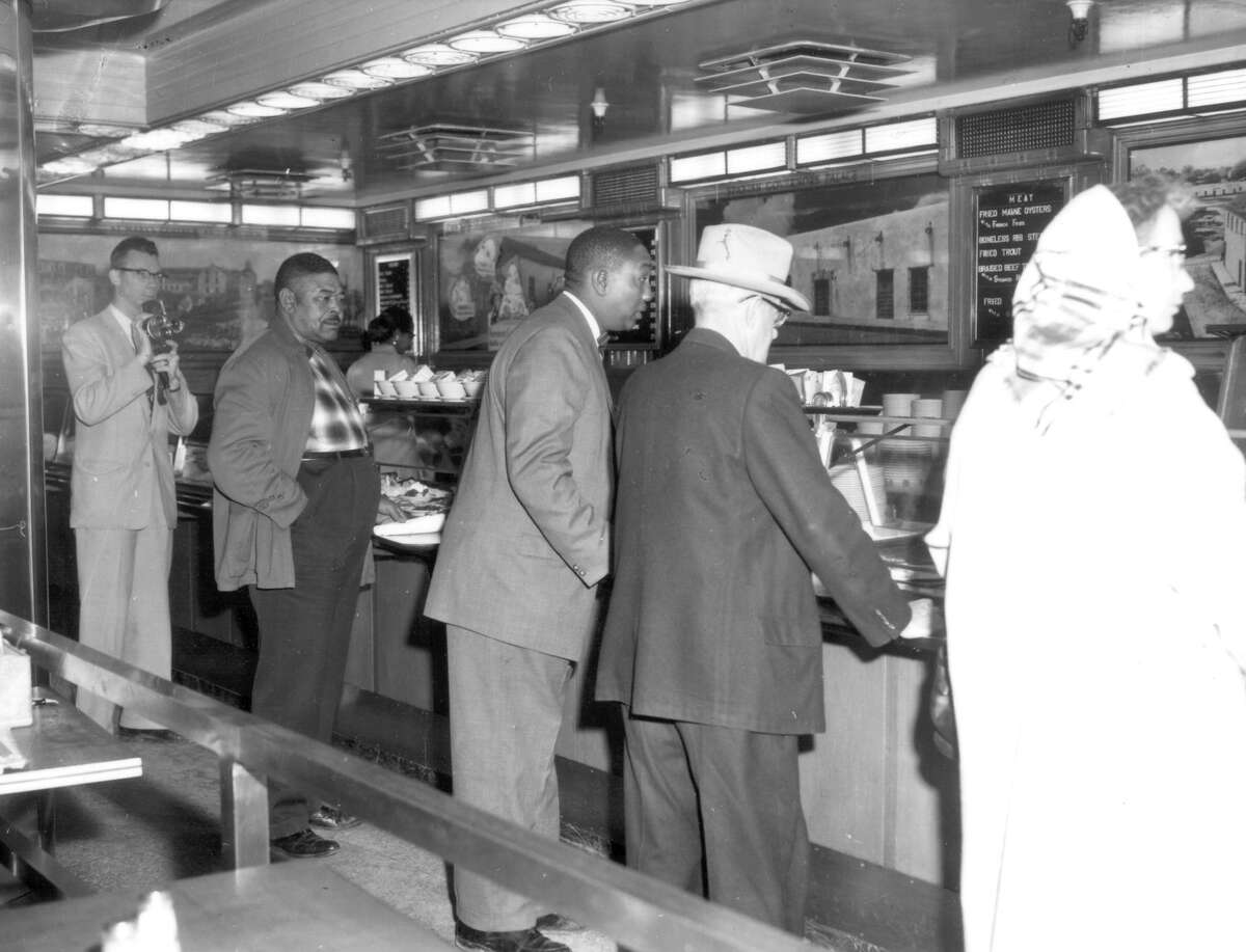 A report recently released by the Alamo says this photo was taken at the lunch counter in the basement of the Kress Building on Houston Street when seven downtown San Antonio lunch counters voluntarily desegregated in 1960. The photo has at times been labeled incorrectly by researchers as having been taken at the Woolworth Building in Alamo Plaza, according to the report.