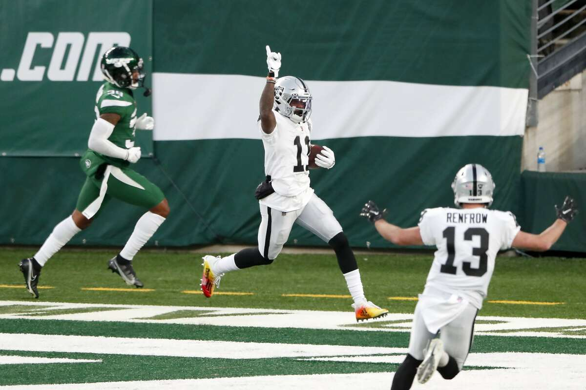 Raiders' receiver Henry Ruggs III, center, celebrates his 46-yard touchdown catch with 5 seconds play that gave Las Vegas a 31-28 win over the Jets.