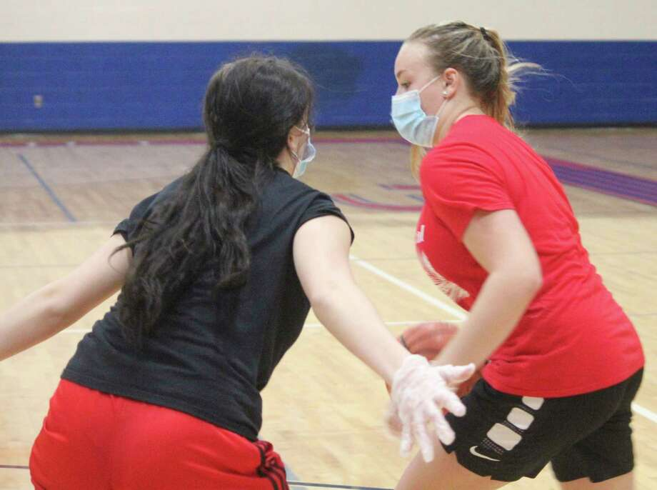 Chippewa Hills' Madison Wrisley (right) works one-on-one against teammate Desiree Brown during a practice on Nov. 9. (Pioneer photo/John Raffel)