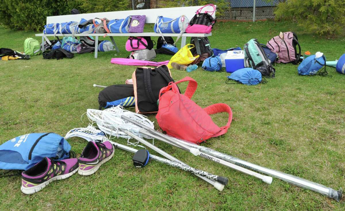 Gym bags and sticks are seen on a sideline of a lacrosse game in a previous spring season. The Ridgefield Parks and Recreation department is going to offer Lacrosse Clinics in the Ridgefield Recreation Center gymnasium from January 26 to March 10 for girls in kindergarten through eighth grade.