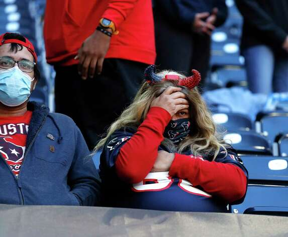 A Houston Texans fan covers her face after Houston Texans quarterback Deshaun Watson fumbled the ball for a turnover in the final minutes during the fourth quarter of an NFL football game at NRG Stadium, Sunday, December 6, 2020, in Houston. Photo: Karen Warren, Staff Photographer / © 2020 Houston Chronicle