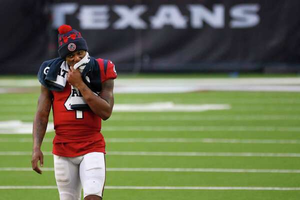 Houston Texans quarterback Deshaun Watson (4) reacts as he walked back to the locker room after he fumbled the ball for a turnover with minutes to go in the game after an NFL football game at NRG Stadium, Sunday, December 6, 2020, in Houston.