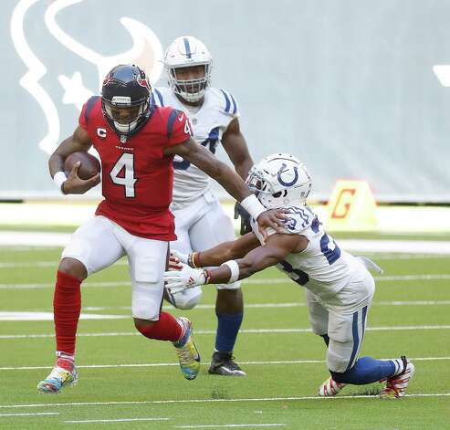 Houston Texans quarterback Deshaun Watson (4) gains yardage against Indianapolis Colts cornerback Kenny Moore II (23) during the second half of an NFL football game at NRG Stadium, Sunday, December 6, 2020, in Houston. Photo: Karen Warren, Staff Photographer / © 2020 Houston Chronicle