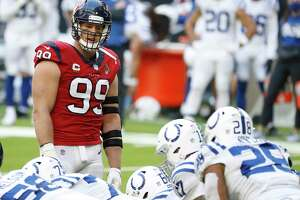 Houston Texans defensive end J.J. Watt (99) reacts as the Indianapolis Colts took a knee to end the game during the fourth quarter of an NFL football game at NRG Stadium, Sunday, December 6, 2020, in Houston.
