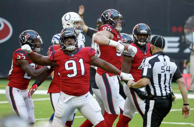 Houston Texans defensive ends Carlos Watkins (91) and J.J. Watt (99) celebrate stopping the Indianapolis Colts during the second half of an NFL football game at NRG Stadium, Sunday, December 6, 2020, in Houston. Photo: Karen Warren, Staff Photographer / © 2020 Houston Chronicle