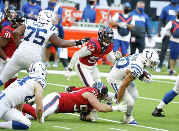 Houston Texans defensive end J.J. Watt (99) tries to stop Indianapolis Colts running back Jordan Wilkins (20) during the second half of an NFL football game at NRG Stadium, Sunday, December 6, 2020, in Houston. Photo: Karen Warren, Staff Photographer / © 2020 Houston Chronicle