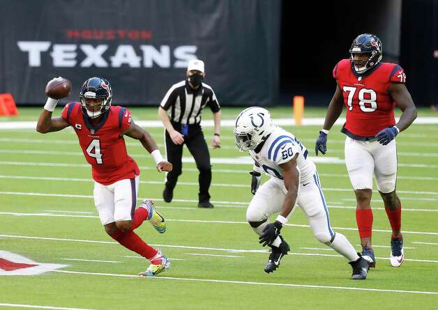 Houston Texans quarterback Deshaun Watson (4) runs the ball against Indianapolis Colts defensive end Justin Houston (50) during the second half of an NFL football game at NRG Stadium, Sunday, December 6, 2020, in Houston. Photo: Karen Warren, Staff Photographer / © 2020 Houston Chronicle