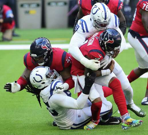 Indianapolis Colts defensive tackle DeForest Buckner (99) sacks Houston Texans quarterback Deshaun Watson (4) during the first half of an NFL football game at NRG Stadium on Sunday, Dec. 6, 2020, in Houston. Photo: Brett Coomer, Staff Photographer / © 2020 Houston Chronicle