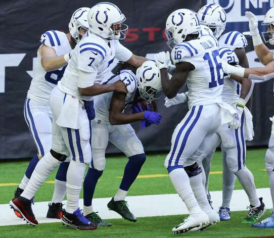 Indianapolis Colts wide receiver T.Y. Hilton (13) is mobbed by his teammates after his 21-yard touchdown reception against the Houston Texans during the first half of an NFL football game at NRG Stadium on Sunday, Dec. 6, 2020, in Houston. Photo: Brett Coomer, Staff Photographer / © 2020 Houston Chronicle