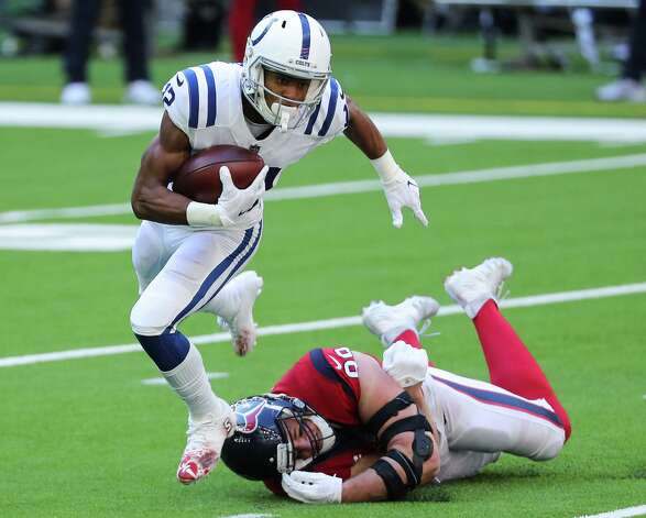 Indianapolis Colts wide receiver De'Michael Harris (12) is tripped up by Houston Texans defensive end J.J. Watt (99) during the first half of an NFL football game at NRG Stadium on Sunday, Dec. 6, 2020, in Houston. Photo: Brett Coomer, Staff Photographer / © 2020 Houston Chronicle