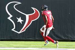 Houston Texans quarterback Deshaun Watson (4) runs in for a touchdown during the first half of an NFL football game at NRG Stadium, Sunday, December 6, 2020, in Houston.