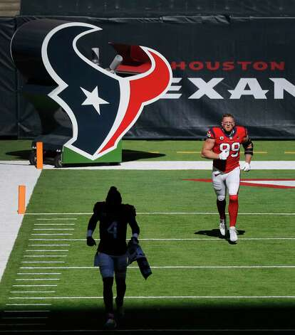 Houston Texans defensive end J.J. Watt (99) along with quarterback Deshaun Watson (4) come out of the tunnel before the start of the first half of an NFL football game at NRG Stadium, Sunday, December 6, 2020, in Houston. Photo: Karen Warren, Staff Photographer / © 2020 Houston Chronicle