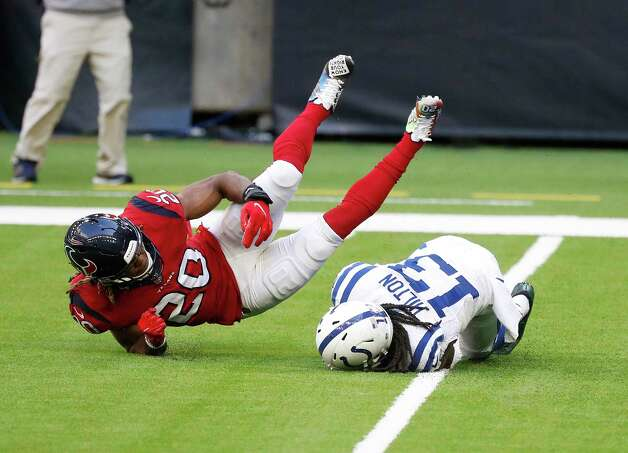 Houston Texans strong safety Justin Reid (20) flies over the top of Indianapolis Colts wide receiver T.Y. Hilton (13) during the first half of an NFL football game at NRG Stadium, Sunday, December 6, 2020, in Houston. Photo: Karen Warren, Staff Photographer / © 2020 Houston Chronicle