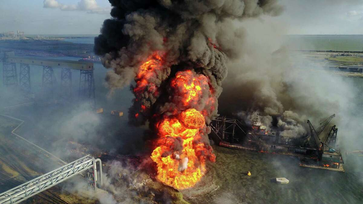 Two major industrial fires have struck Corpus Christi this year. In this photo, a dredging vessel damaged an underwater pipeline in August and caused an explosion in the Corpus Christi ship channel, killing four crew members. On Saturday, seven workers cleaning a petrochemical storage tank were injured by an explosion and fire.