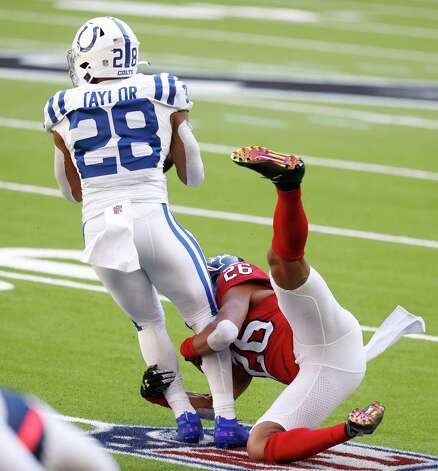 Houston Texans cornerback Vernon Hargreaves III (26) tries to stop Indianapolis Colts running back Jonathan Taylor (28) during the first half of an NFL football game at NRG Stadium, Sunday, December 6, 2020, in Houston. Photo: Karen Warren, Staff Photographer / © 2020 Houston Chronicle