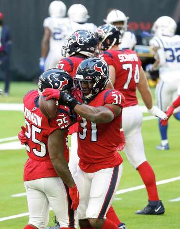 Houston Texans running back David Johnson (31) hugs Duke Johnson (25) after his touchdown during the first half of an NFL football game at NRG Stadium, Sunday, December 6, 2020, in Houston. Photo: Karen Warren, Staff Photographer / © 2020 Houston Chronicle