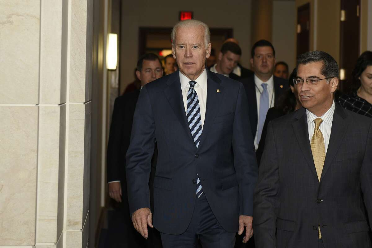 Vice President Joe Biden, accompanied by House Democratic Caucus Chairman Rep. Xavier Becerra, D-Calif., arrives on Capitol Hill in Washington, Tuesday, Dec. 6, 2016, to address the House Democratic Caucus. President-elect Biden has nominated Becerra to become the next Health and Human Services Secretary.
