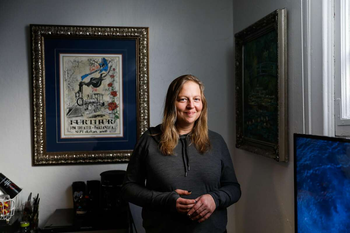 Jenn Oakley, who was previously homeless, stands for a portrait in her new studio apartment on Tuesday, Dec. 1, 2020 in Berkeley, California.This is the first time she�s had a place of her own in twelve years.